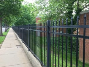 York College: First a fence and then a hand across it